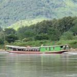 Auf dem Langbot den Mekong rauf